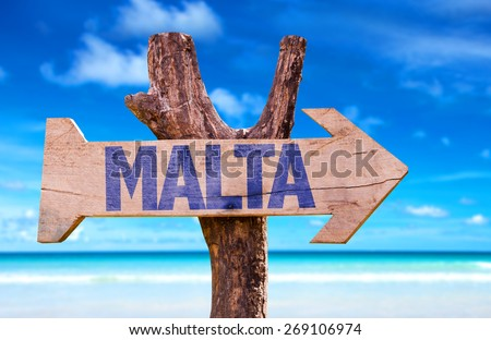 Malta wooden sign with beach background - stock photo