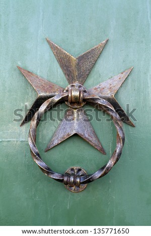 Maltese cross door knocker - stock photo