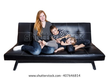 Mama with kids at the sofa isolated on white background - stock photo