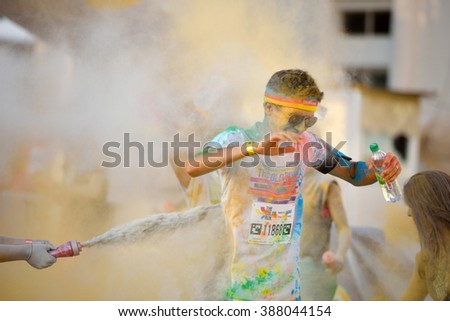 MAMAIA, CONSTANTA, ROMANIA - AUGUST 1: Mamaia color run 2015, in Mamaia, Constanta, on August 1, 2015. People from all walks of life participating in the fun colored summer run - stock photo