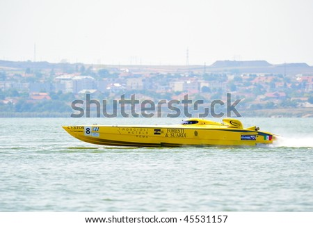 MAMAIA, ROMANIA - AUGUST 29: Boat of the team Foresti & Suardi, in first race of the Class One Romanian Grand Prix August 29, 2009 in Mamaia, Romania - stock photo