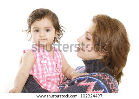 Mamma's baby a cute toddler in loving mother's arms