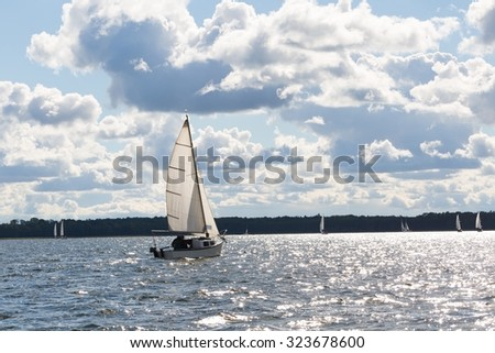 Mamry lake in Poland with sailboats photographed i early autumn. Yacht or boats on beautiful lake in Mazury lake district.  - stock photo
