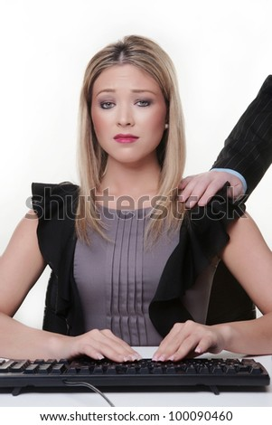 mams hand pointing at a young woman working at her desk she not looking to happy has she done something wrong - stock photo