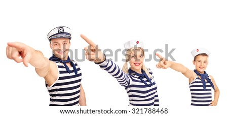 Man, a woman and a child in sailor outfits pointing forward with their hands and looking at the camera isolated on white background - stock photo