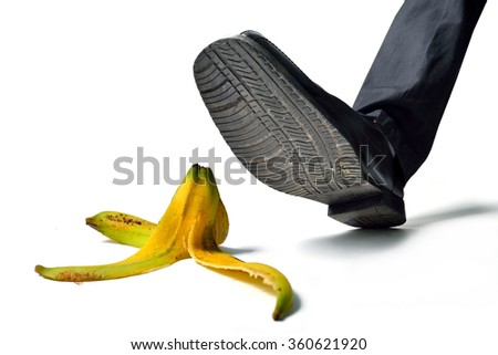 man about to step on banana peel - stock photo