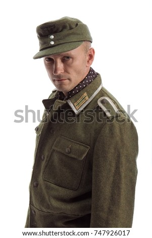 Man actor in the movie role of an old military man posing against white background