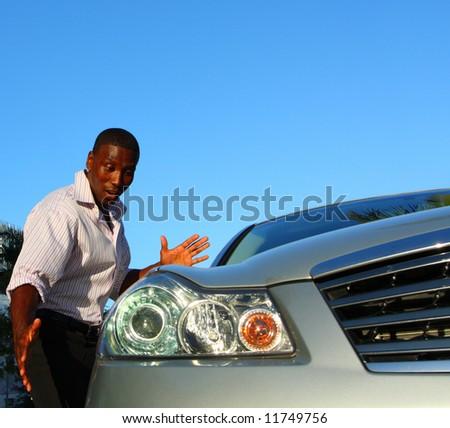 Man admiring his new car - stock photo