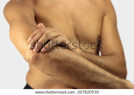 man affected by Tennis elbow or lateral epicondylitis - stock photo