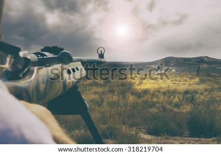 man aiming and shooting at range targets with puffs of dirt from missing target with a retro instagram toned filter - stock photo