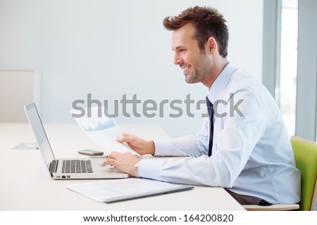 Man analyzing financial data in the office - stock photo