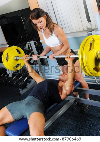 man and a woman trained in the gym Bar Bench Press