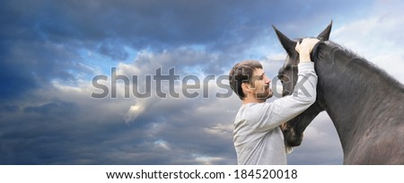 man and  black horse against  background of clouds of sky, banner for website - stock photo