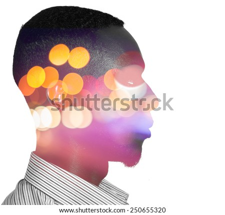 Man and blurred night lights double exposure - stock photo