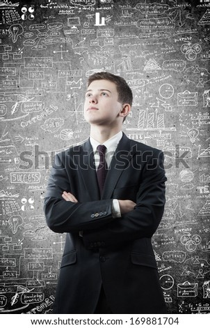 man and business strategy on the wall - stock photo