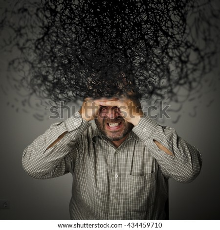 Man and chaos in mind. Frustrated man. - stock photo
