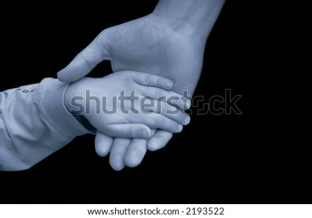 man and child holding hands - help or charity