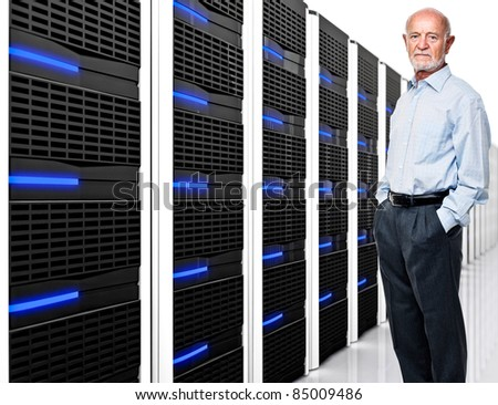 man and  datacentre with lots of server - stock photo