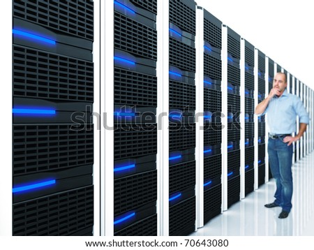 man and datacentre with lots of server selective focus image