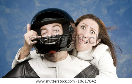 Man and fearful woman on a motorcycle in studio - stock photo