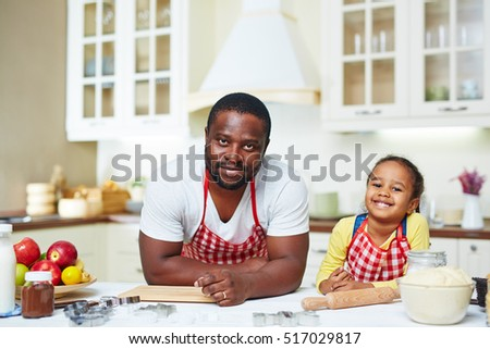 Man and girl in the kitchen