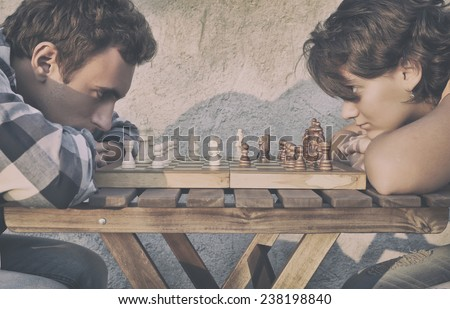 Man and girl playing chess - stock photo