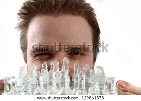 man and glass chess - stock photo