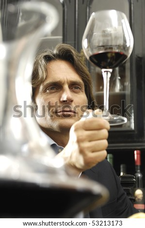 man and glass of wine - stock photo
