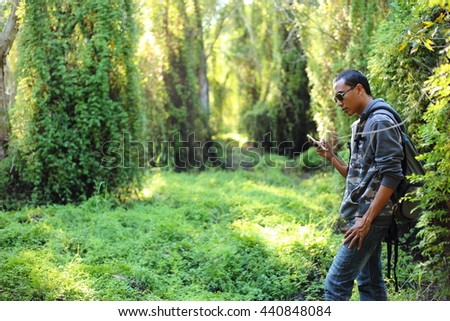 Man and Green Forest in Rayong at Thailand
