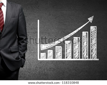 man and growth chart  on concrete wall - stock photo