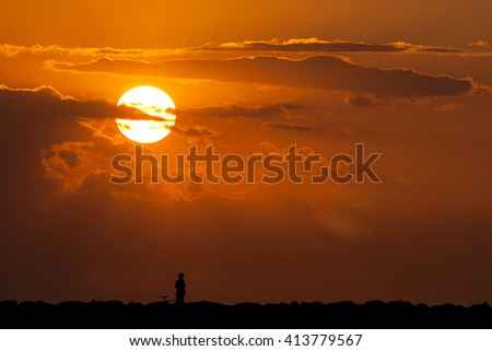 Man and his bicycle at beautiful sunset