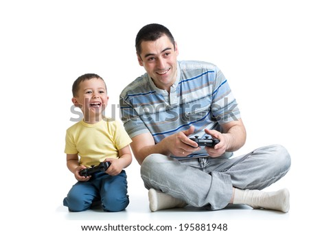 man and his son play with a playstation together - stock photo