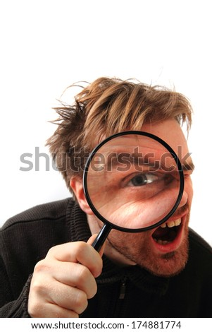 man and magnify glass - stock photo