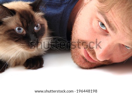 man and ragdoll cat isolated on the white background - stock photo