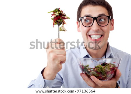 Man and salad. Focused on fork - stock photo