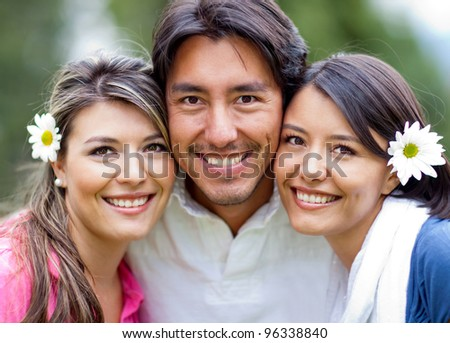 Man and two lovely girls - siblings portrait outdoors - stock photo