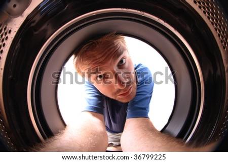 man and washing machine - stock photo