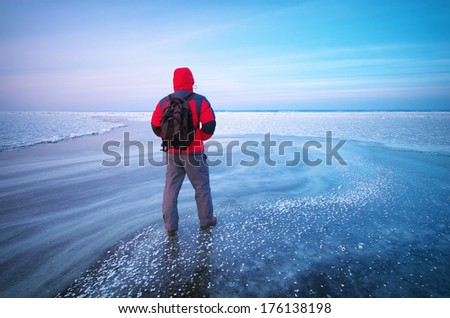 Man and winter ice. Nature composition.