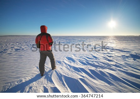 Man and winter sunlight. Nature composition.