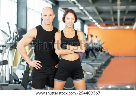 Man and woman after sport exercises at the fitness gym.