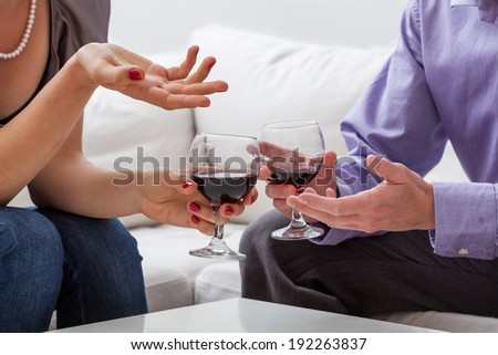 Man and woman are drinking red vine
