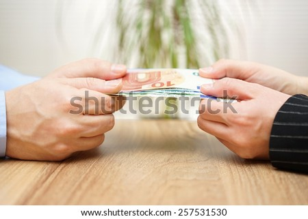 man and woman are fighting over money - stock photo
