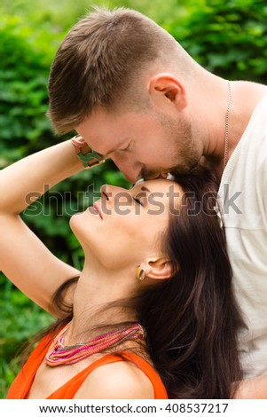 man and woman are hugging and kissing