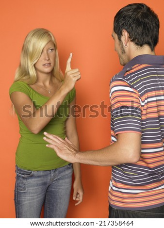 Man and woman arguing - stock photo