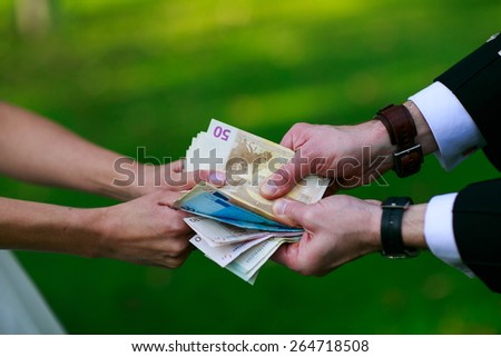 man and woman arguing over money - stock photo