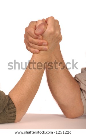 Man and woman arm wrestle - stock photo