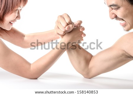 Man and woman arm-wrestle isolated