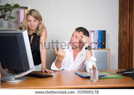 Man and woman at office
