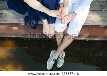 man and woman at the lake to spend time in each other's arms - stock photo