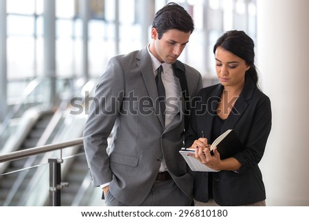 Man and woman business executive attorney in a suit team secretary leader - stock photo